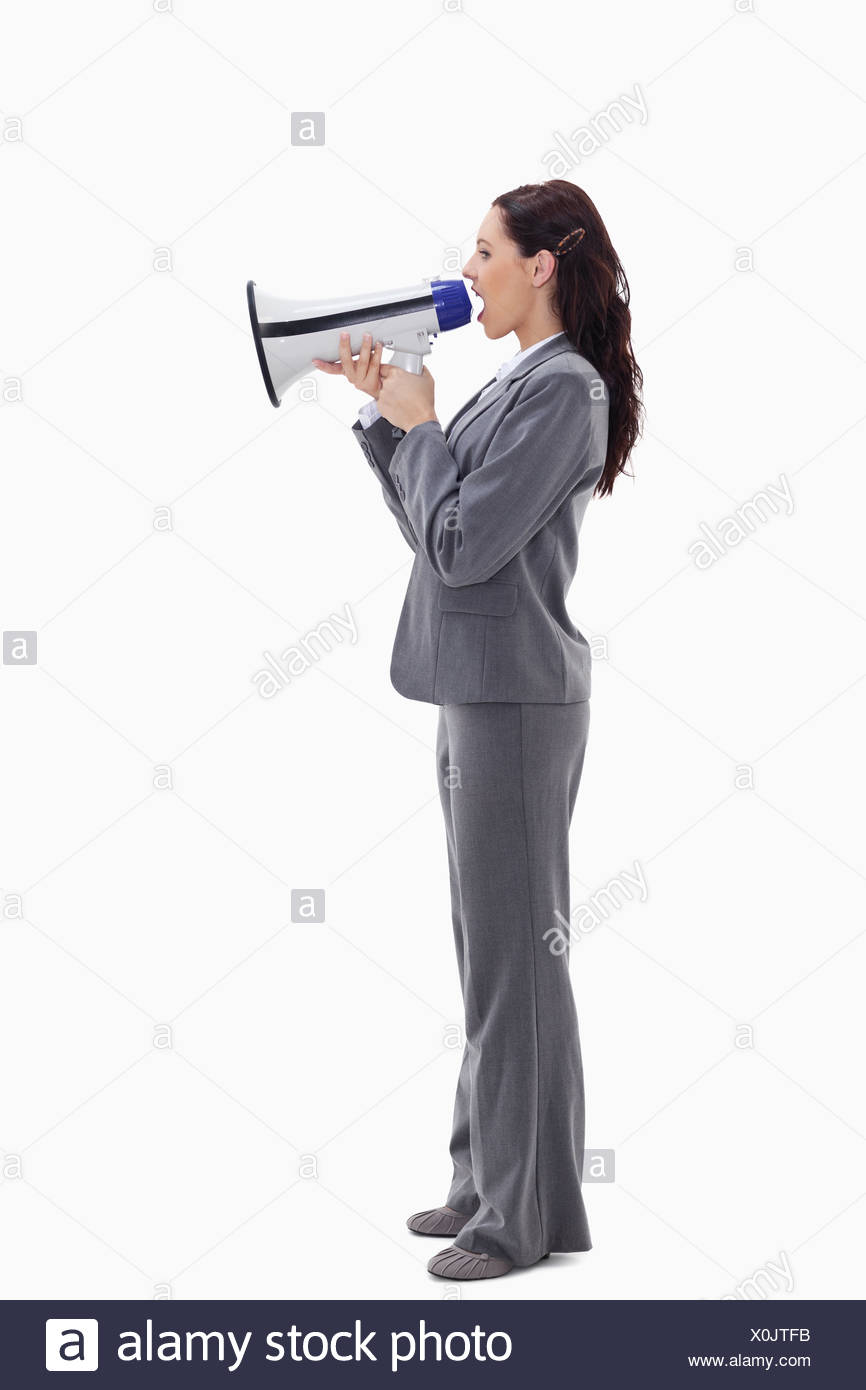 Businesswoman speaking loudly into a megaphone Stock Photo