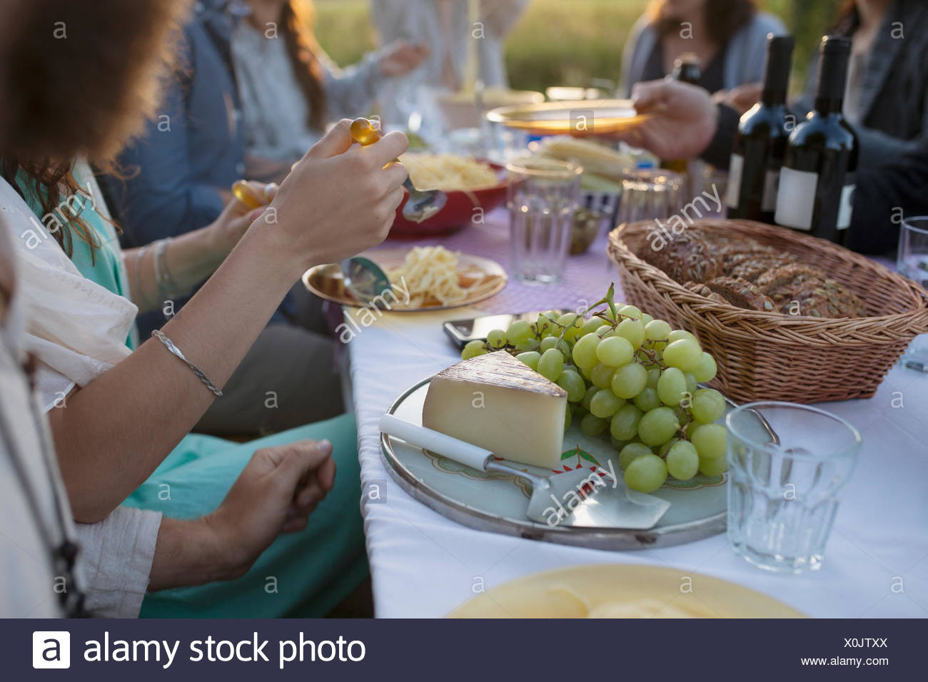 Grapes and cheese on platter at garden party dinner table - Stock Image