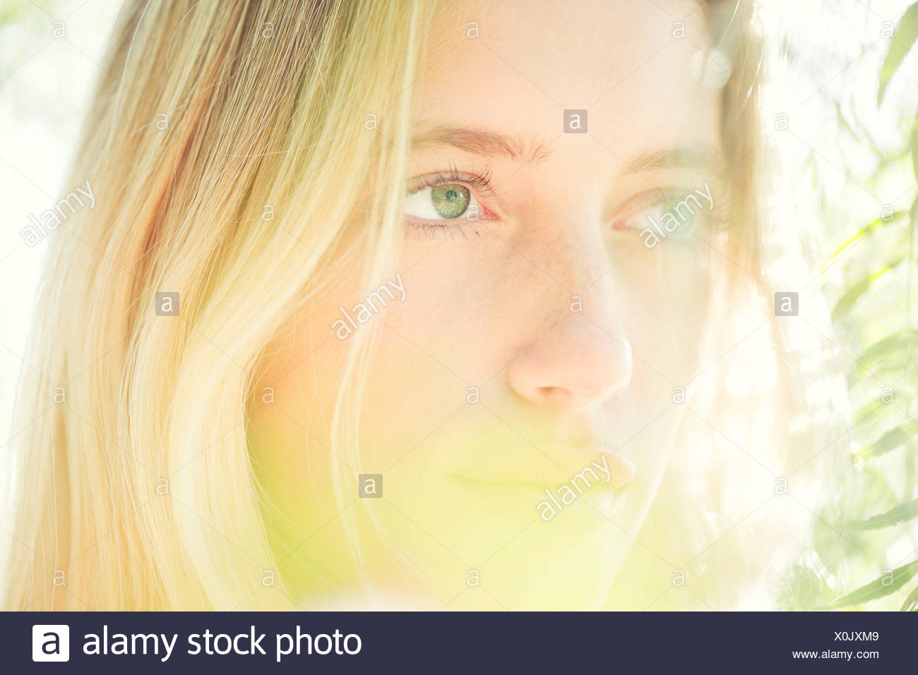 Woman daydreaming, portrait - Stock Image