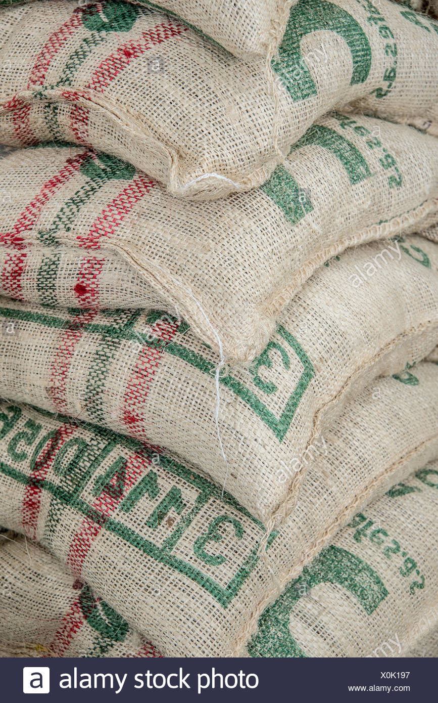 Sacks of coffee beans at a coffee importer's warehouse Stock Photo
