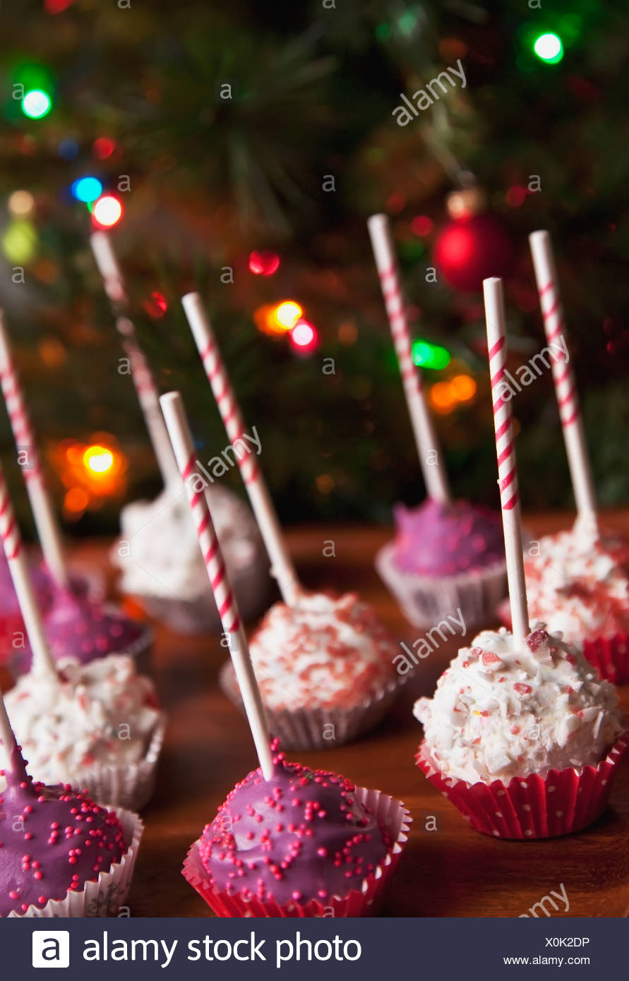 Decorated Pink Cake Pops In Front Of A Christmas Tree Edmonton