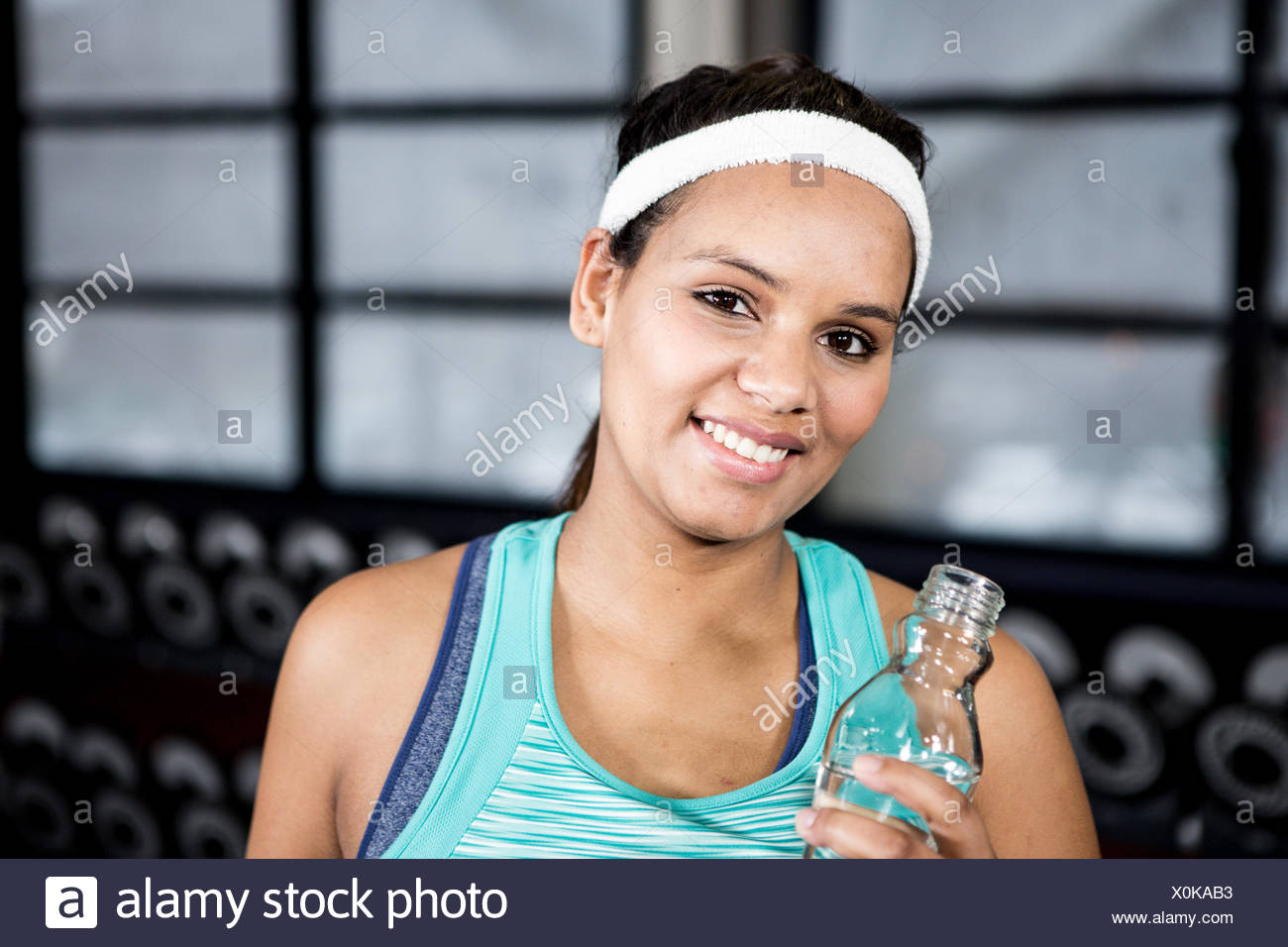Pregnant woman with water bottle - Stock Image