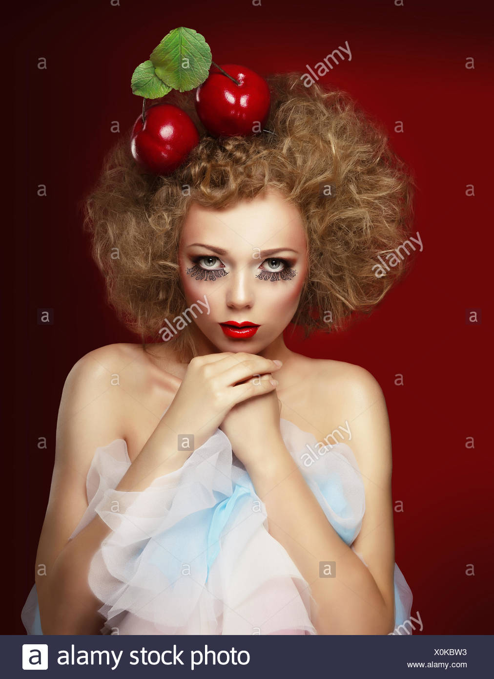 Doll woman with cherries. Stock Photo