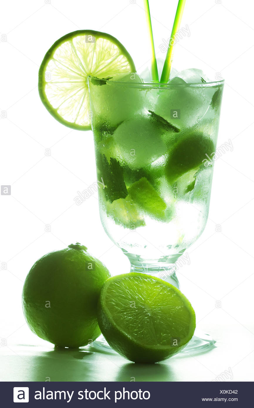 Mojito and limes in counter light - Stock Image
