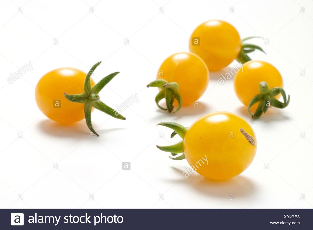 Tomato varieties: yellow cherry tomato - Stock Image