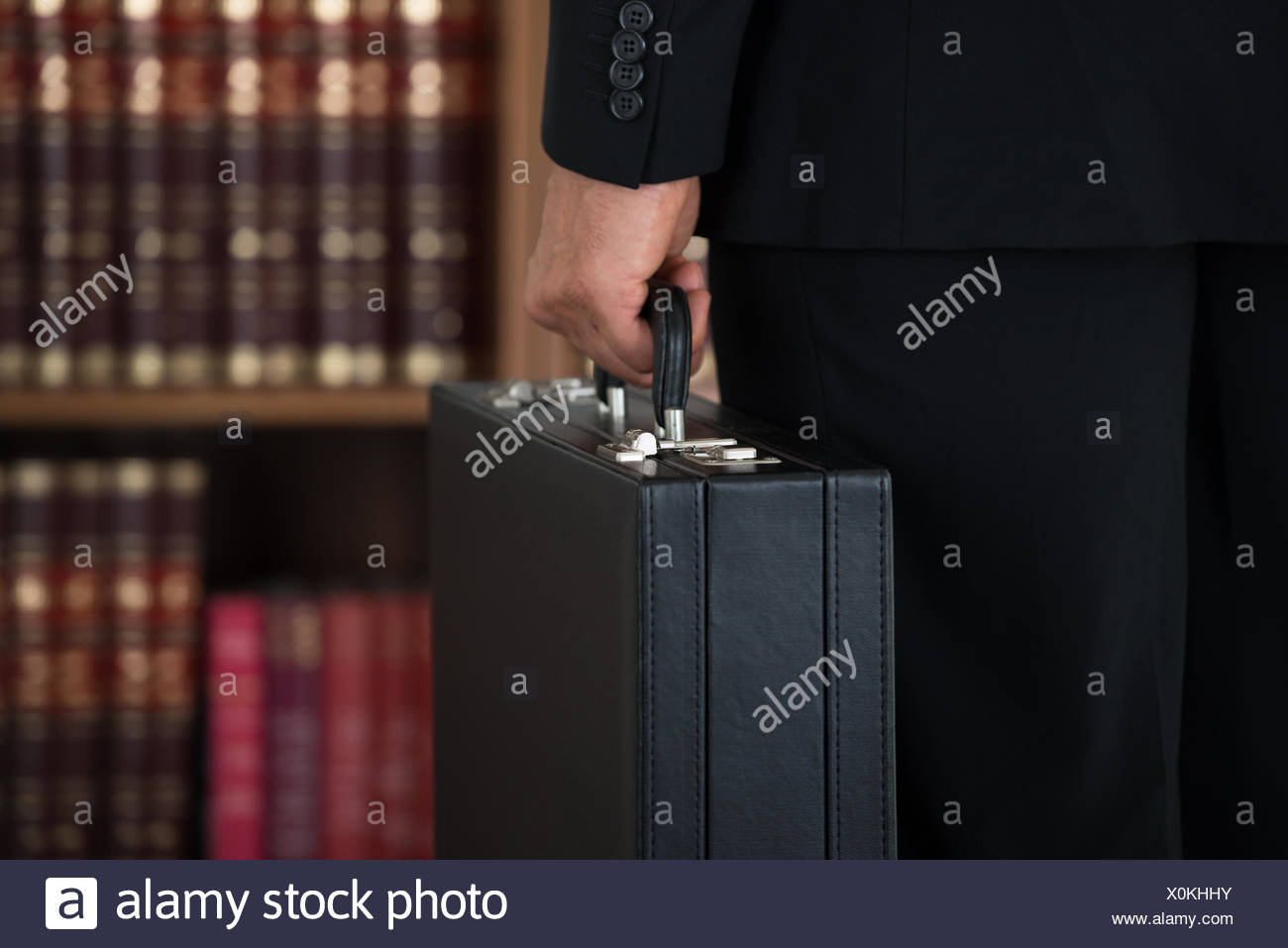 Businessman Carrying Briefcase In Office - Stock Image