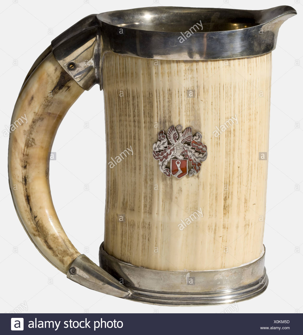 Hermann Göring, an ivory hunting pitcher Ivory, trimmed with silver-plated non-ferrous metal, the interior lined with the same material. The grip is a heavy boar's tusk. Göring's coat of arms in silver highlighted with red enamel is mounted on one side (one expansion crack). Height 18.7 cm. Magnificent pitcher. historic, historical, 1930s, 1930s, 20th century, NS, National Socialism, Nazism, Third Reich, German Reich, Germany, German, National Socialist, Nazi, Nazi period, fascism, fine arts, art, art object, art objects, artful, precious, collectible, collecto, Additional-Rights-Clearances-NA - Stock Image