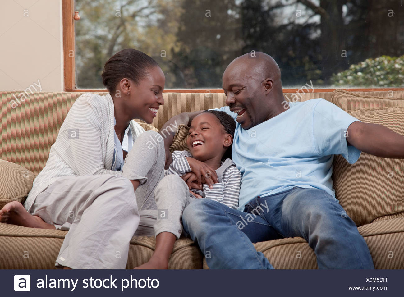 Parents and daughter laughing together, Illovo Family, Johannesburg, South Africa. - Stock Image