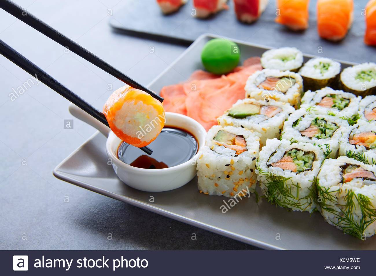 Sushi Maki and Niguiri with soy sauce and wasabi with California Roll. - Stock Image