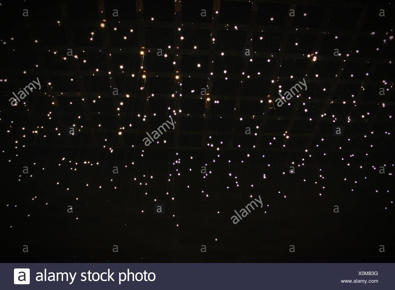 Low Angle View Of Stars On Dark Sky - Stock Image