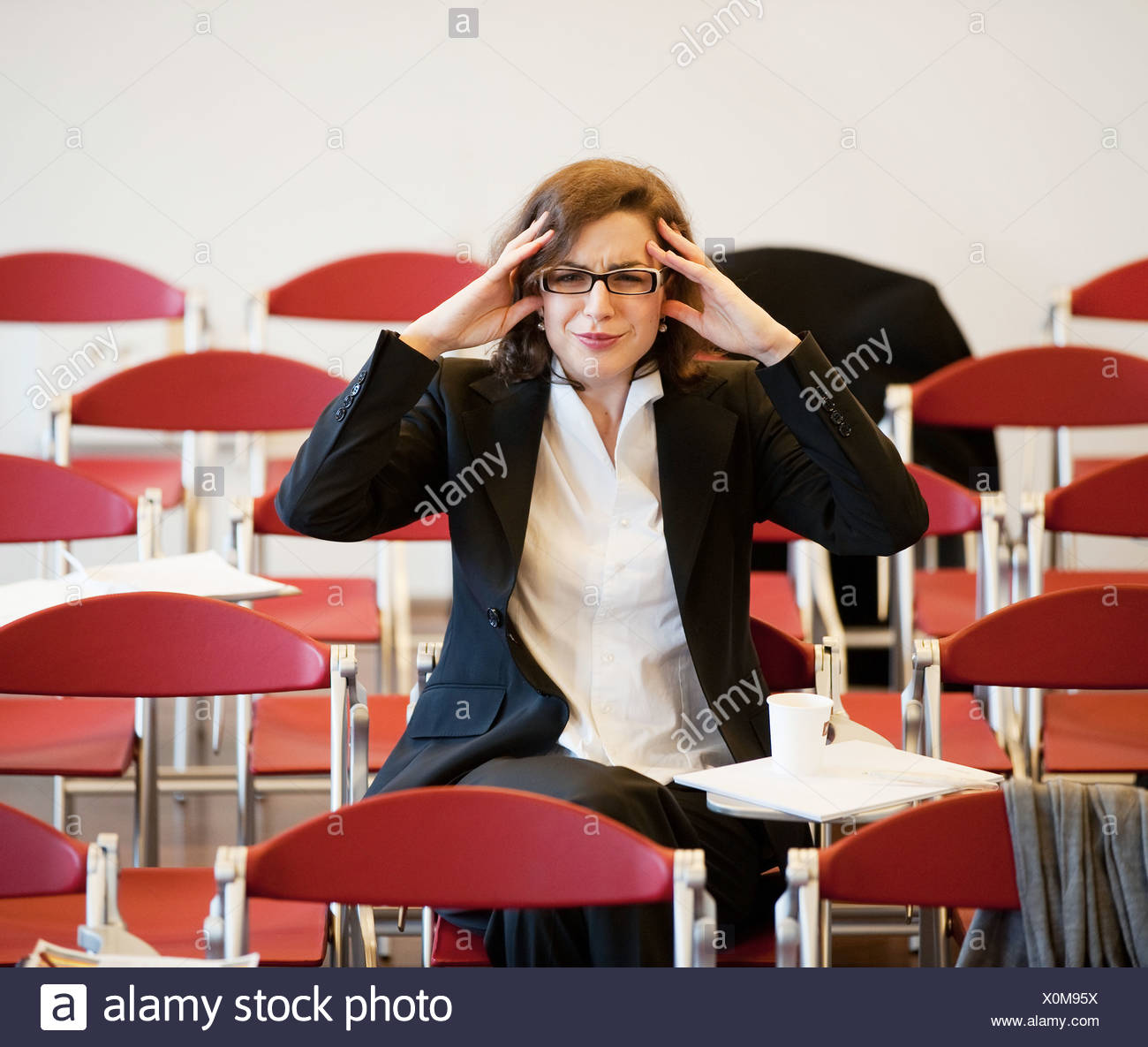 businesswoman stressed out after meeting - Stock Image