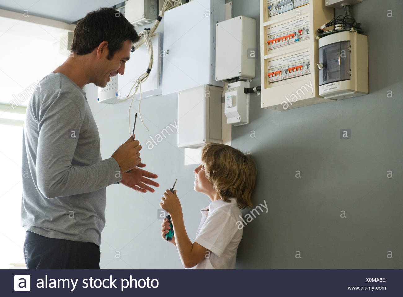 Home Fuse Box Stock Photos Images Alamy Son Helping Father With Improvement Image