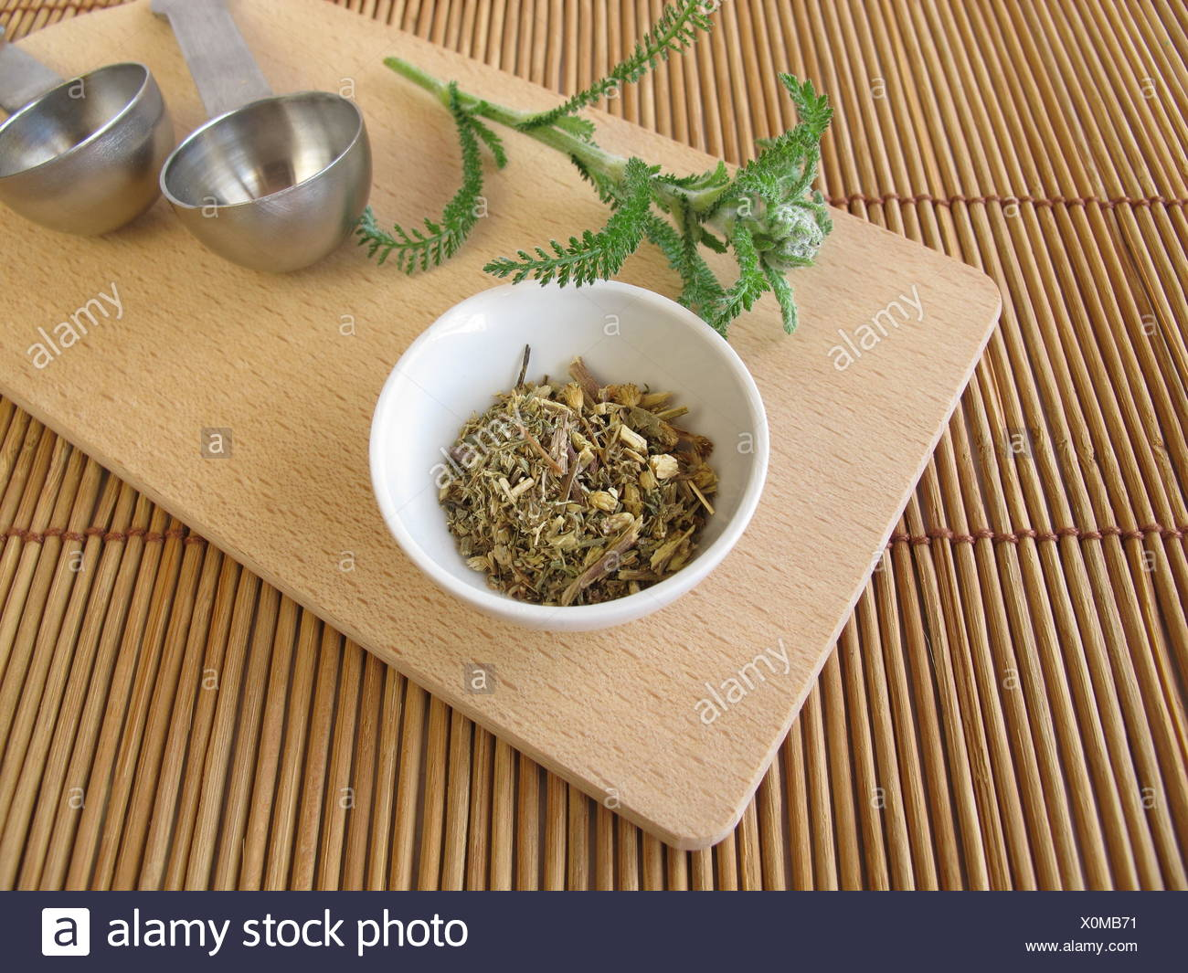 tea yarrow tea leaves blossoms material drug anaesthetic addictive drug drugs compositae dried means agent medicine remedy - Stock Image