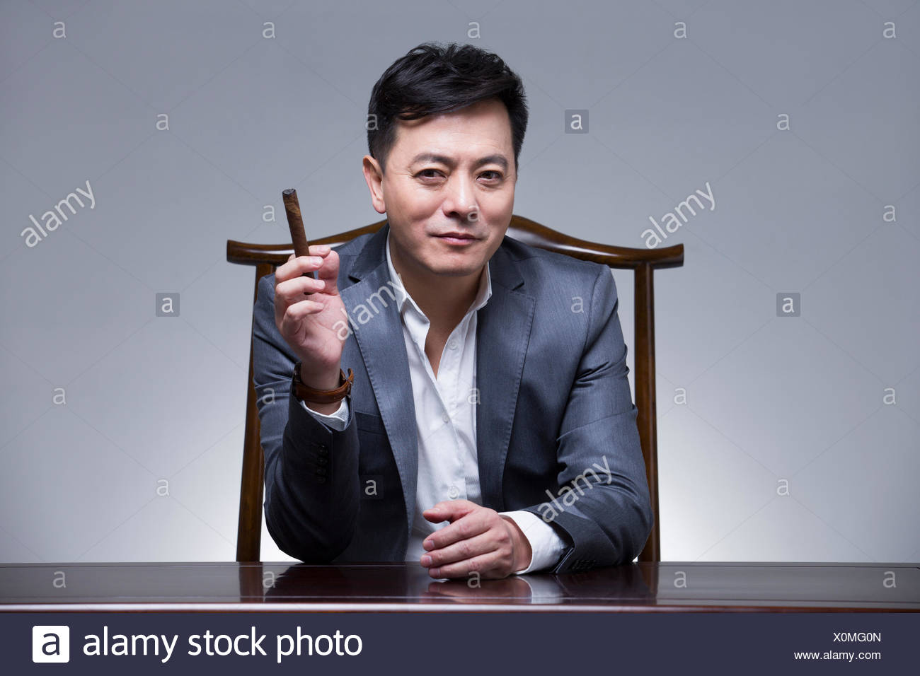 Wealthy mature businessman Stock Photo