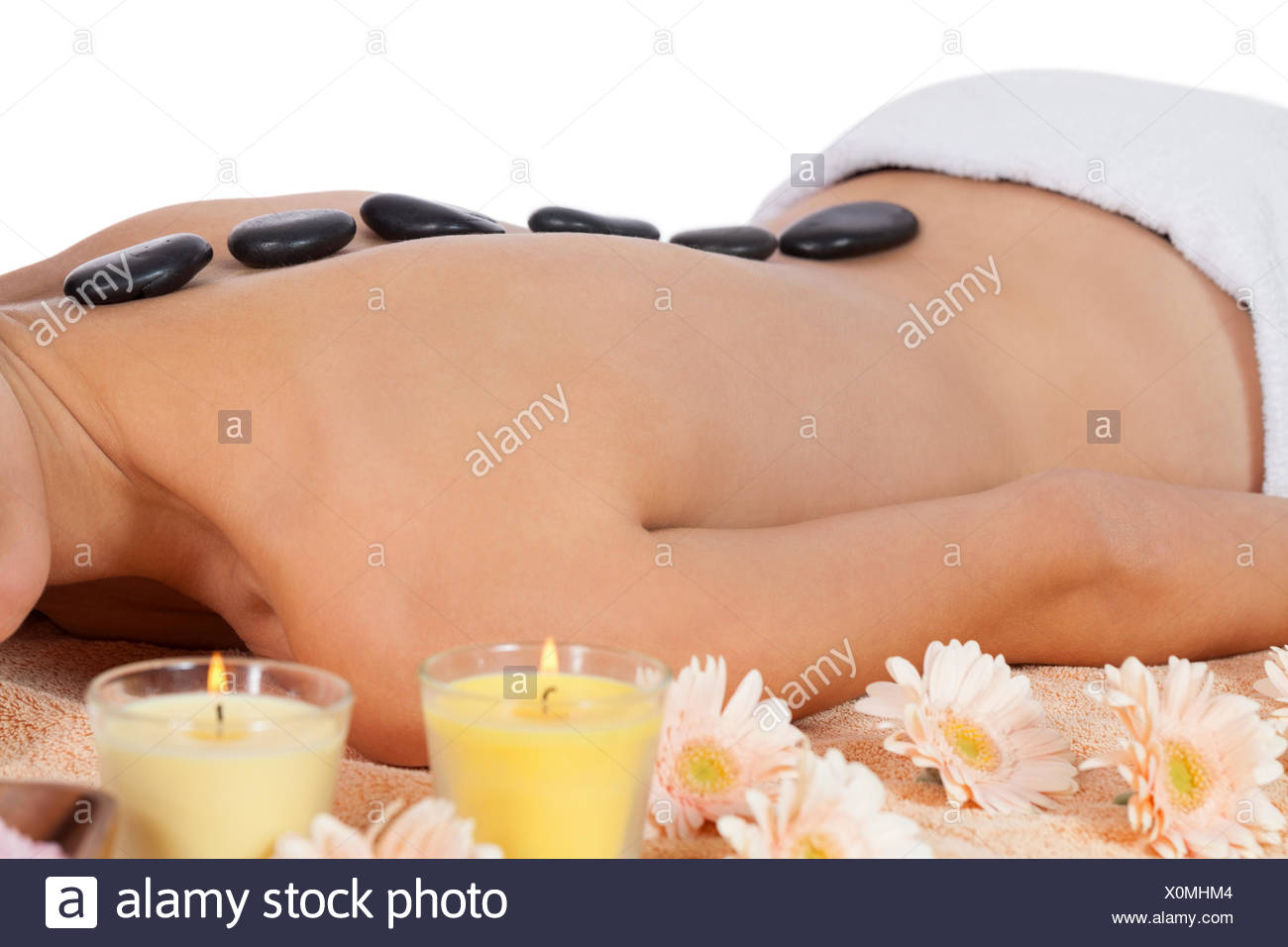 Young Attraktve Woman Gets A Hot Stone Massage