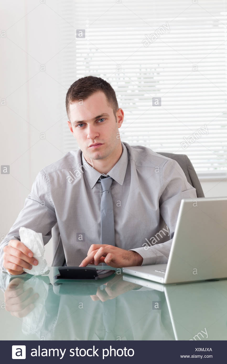 Businessman checking an invoice - Stock Image