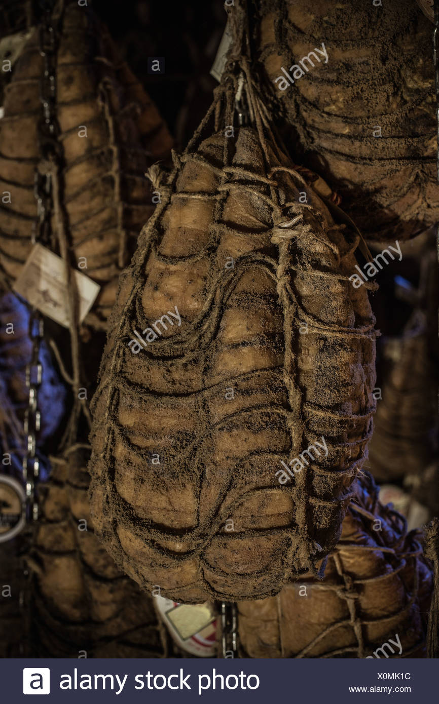 Meat aging in cellar - Stock Image