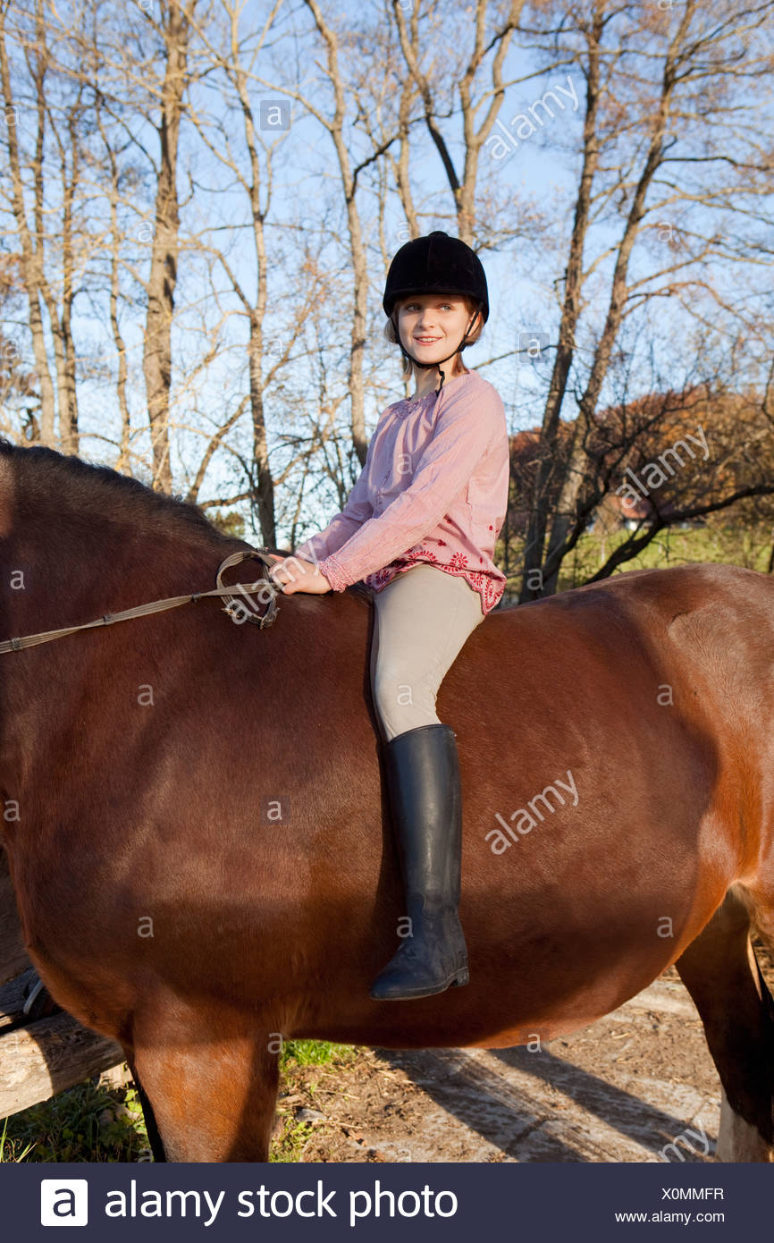 Girl on horseback - Stock Image