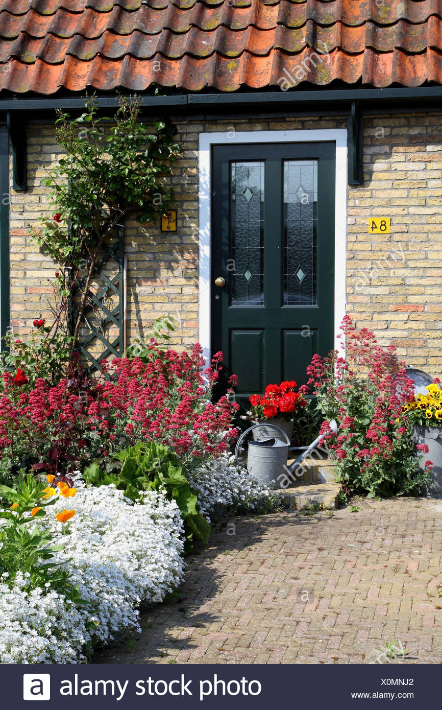 House, front yard, flowers, - Stock Image