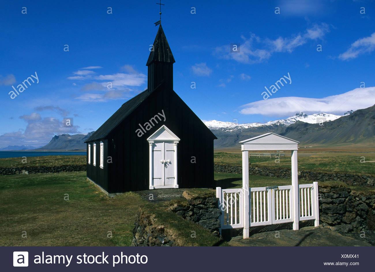 Budir Iceland church gate stone wall mountains wooden church - Stock Image