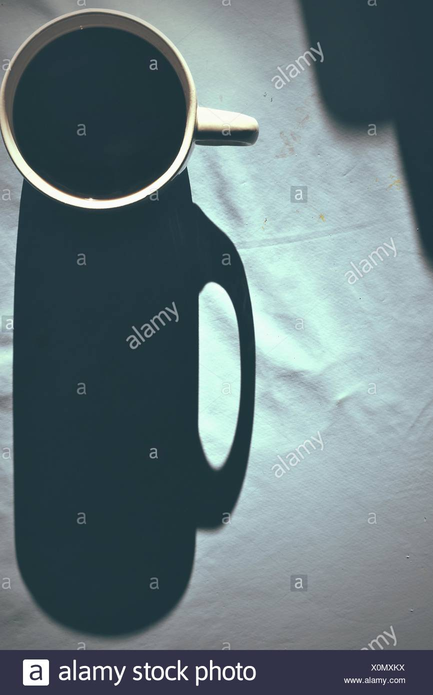 Directly Above Shot Of Coffee Cup Shadow - Stock Image