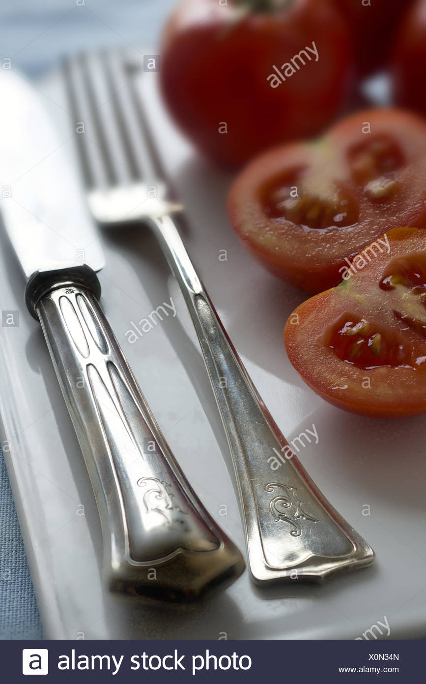 Old silver cutlery (Jugendstil) and Tomatoes - Stock Image