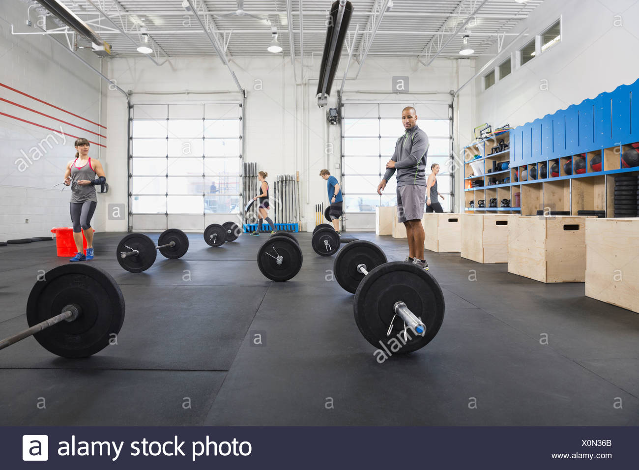 Group of people setting up Crossfit class - Stock Image