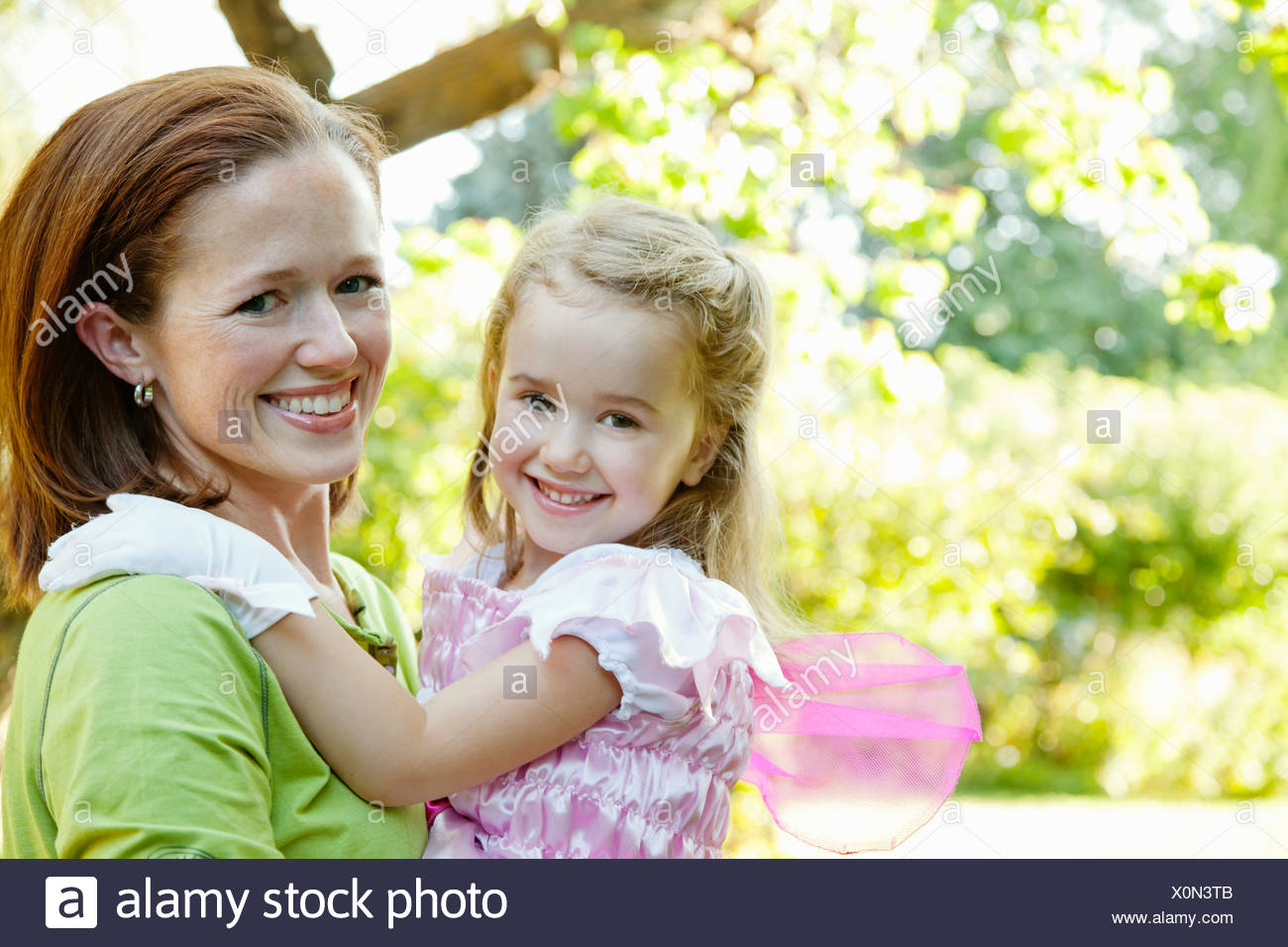 Mother and daughter hugging and smiling Stock Photo