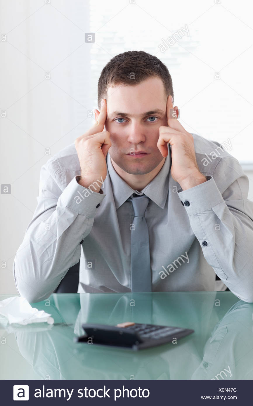 Businessman disappointed with his calculations Stock Photo