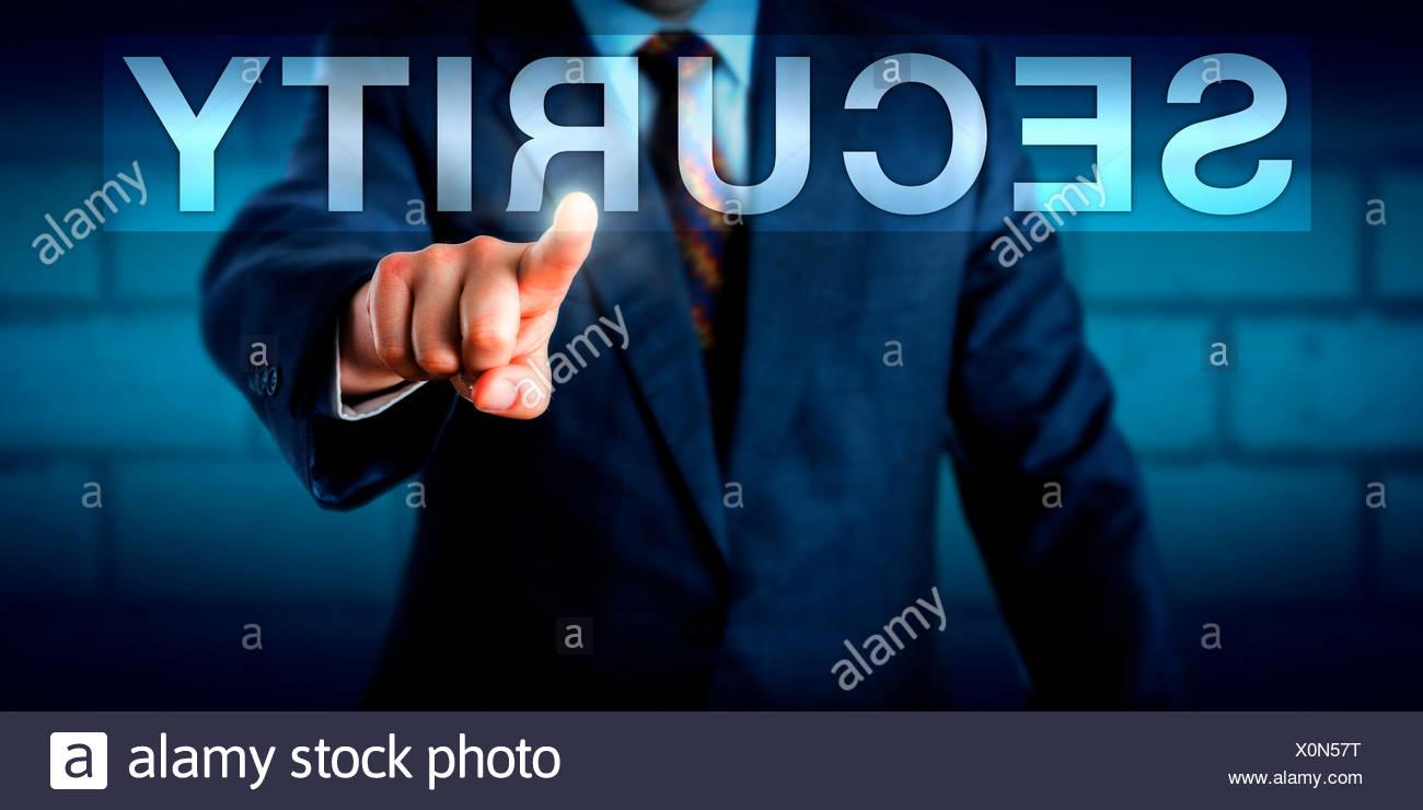 Executive Pressing SECURITY Button Onscreen - Stock Image