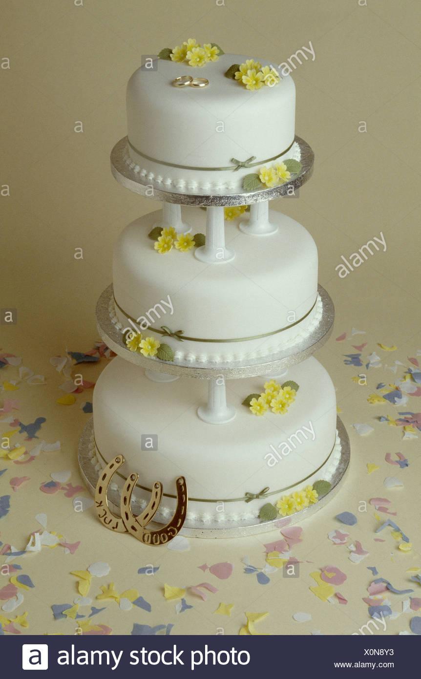Three Tiered Wedding Cake White Icing Yellow Sugar Flowers And