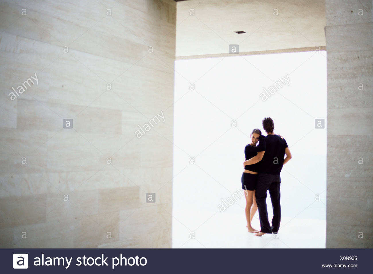 Couple in spacious room - Stock Image