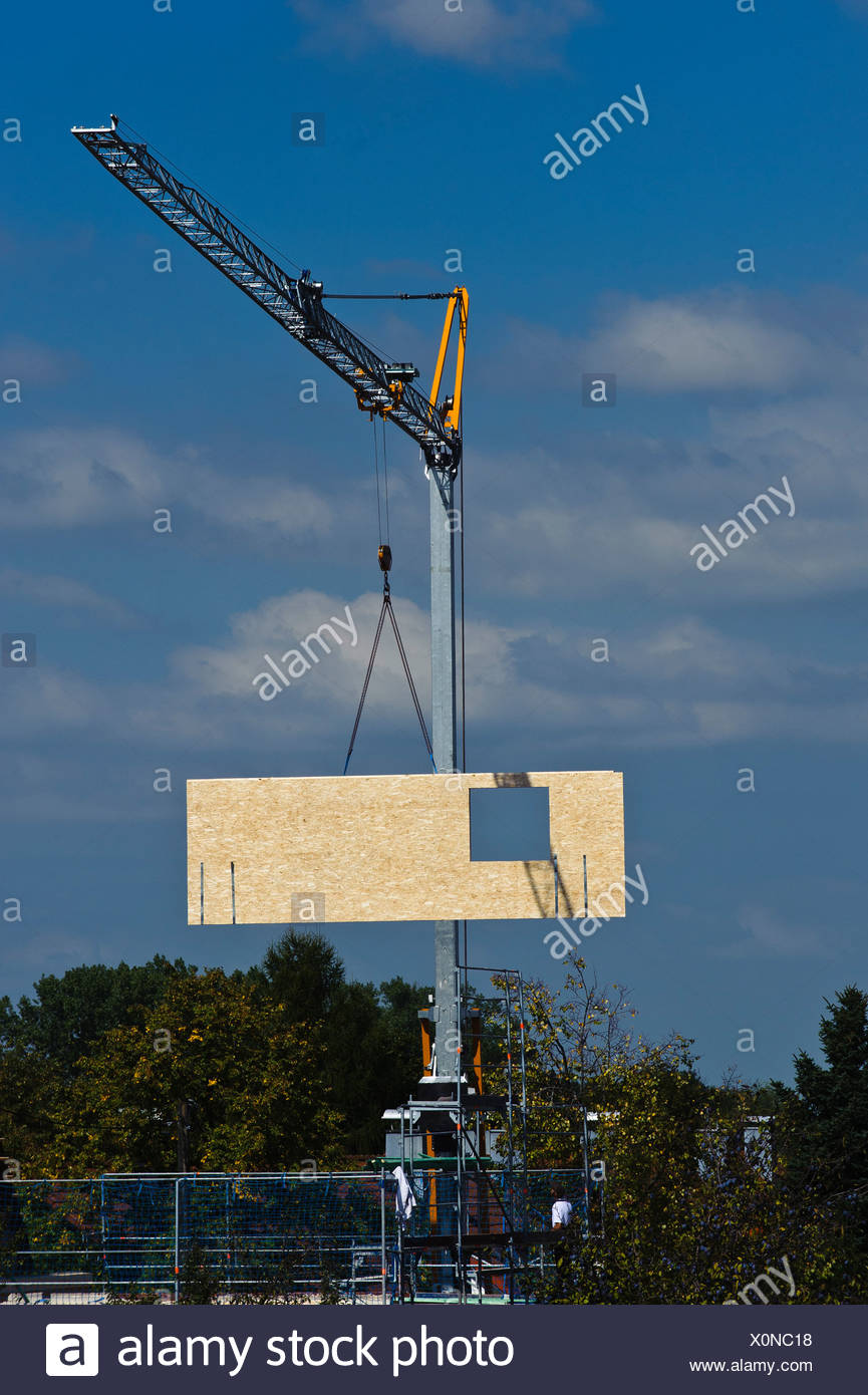 Crane lifting element of a prefabricated house on the construction site - Stock Image