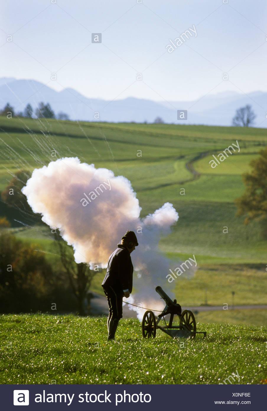 Greimharting Chiemgau Upper Bavaria Germany shooter firering a saluting gun - Stock Image