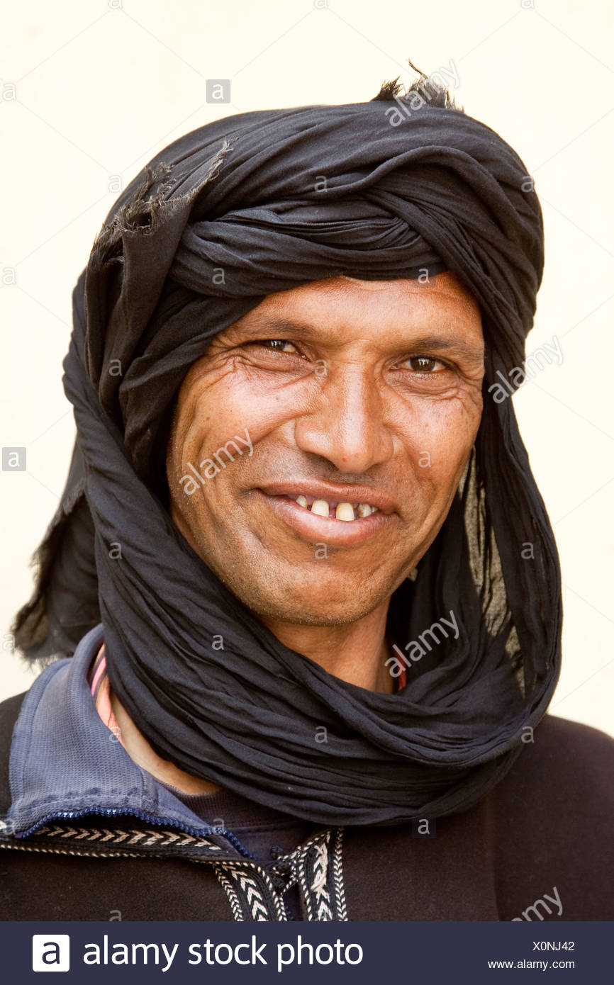 Berber wearing a Djellaba, a traditional robe, near Asni, Morocco, Africa - Stock Image