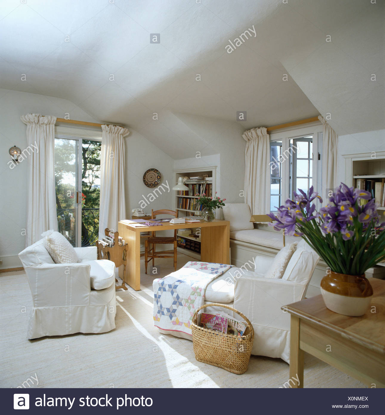 White Armchair And Patchwork Quilt On Chaiselongue In White Attic Sitting Room With Study Corner Stock Photo Alamy