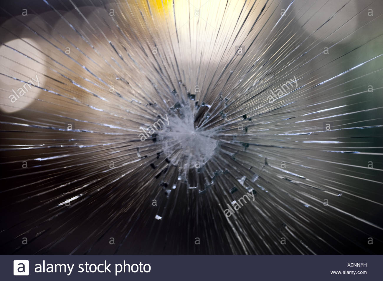 Bullet hole, safety glass pane, detail, - Stock Image