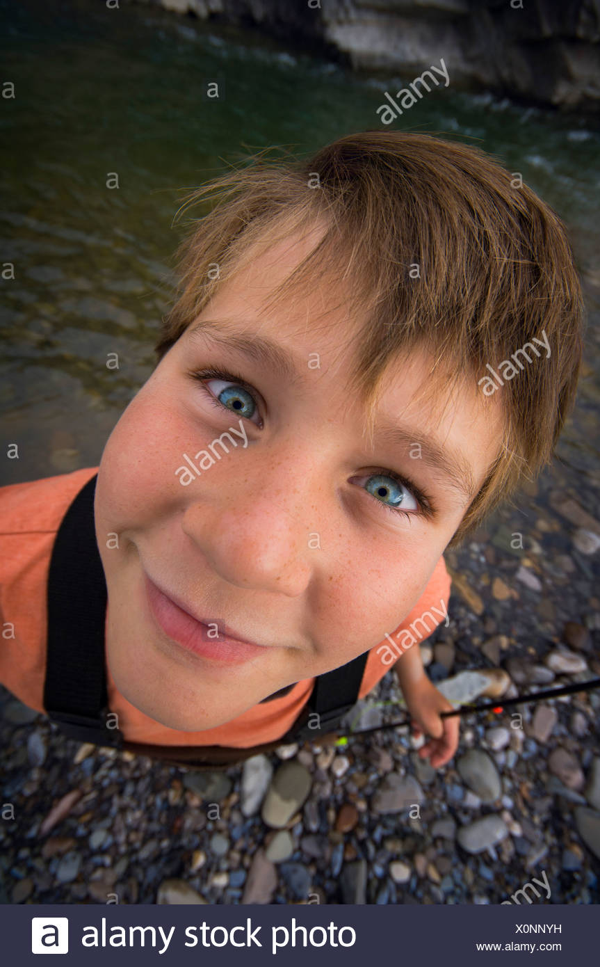 Boy fishing in river Stock Photo