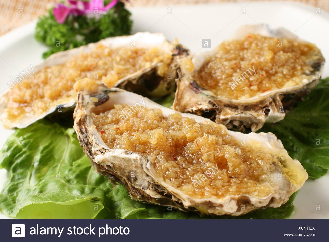 Grilled oysters Stock Photo: 275846114 - Alamy