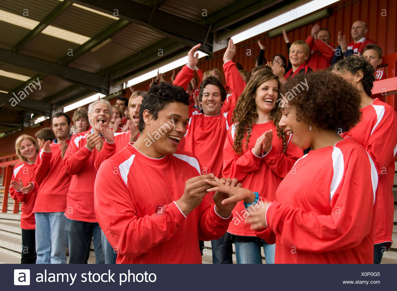 Marriage proposal at football match - Stock Image