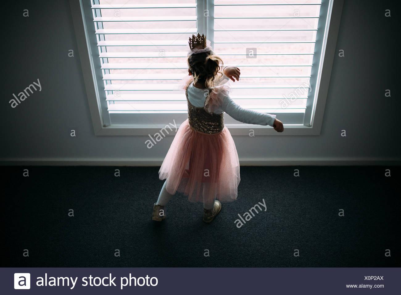 Girl in tutu dress dancing - Stock Image