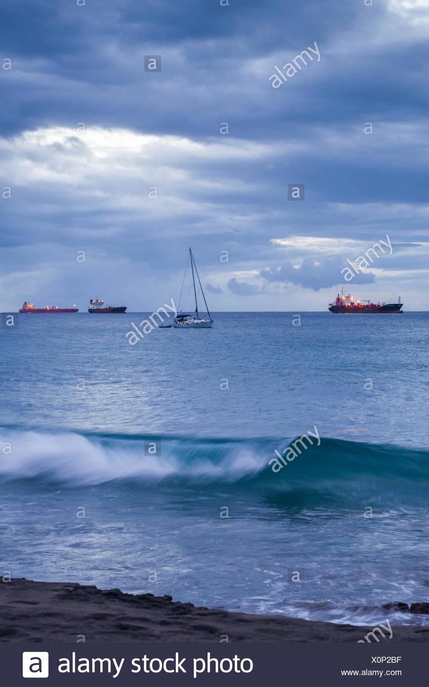 Netherlands, Sint Eustatius, Oranjestad, Oranjestad Bay, oil tankers, dusk Stock Photo