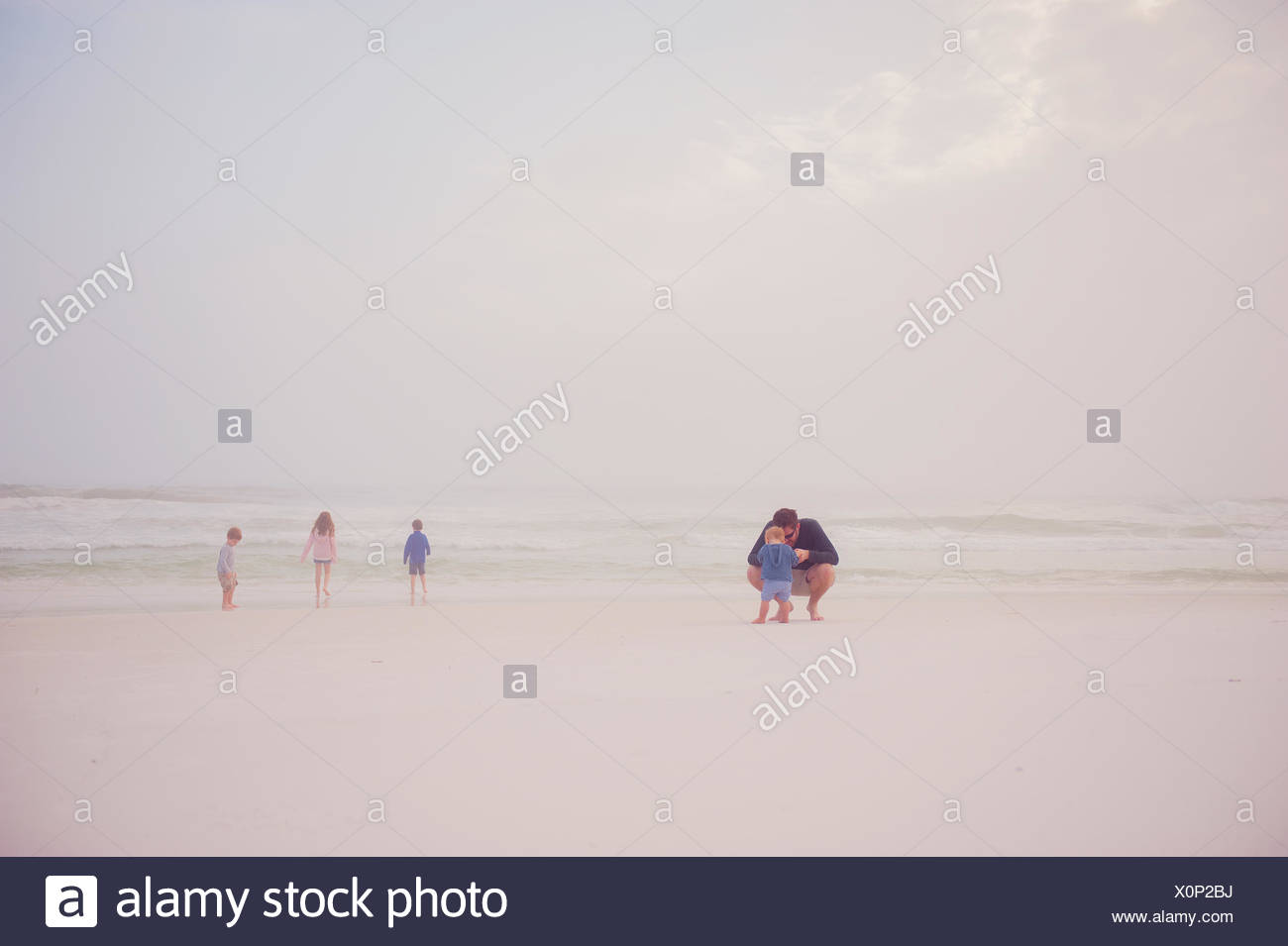Family on a beach - Stock Image