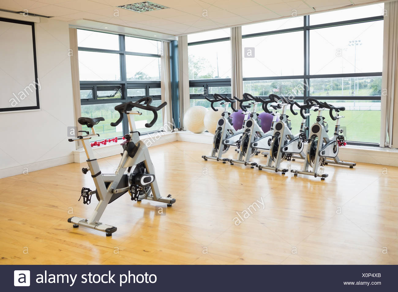 Spinning exercise bikes in gym room stock photo: 275852707 alamy