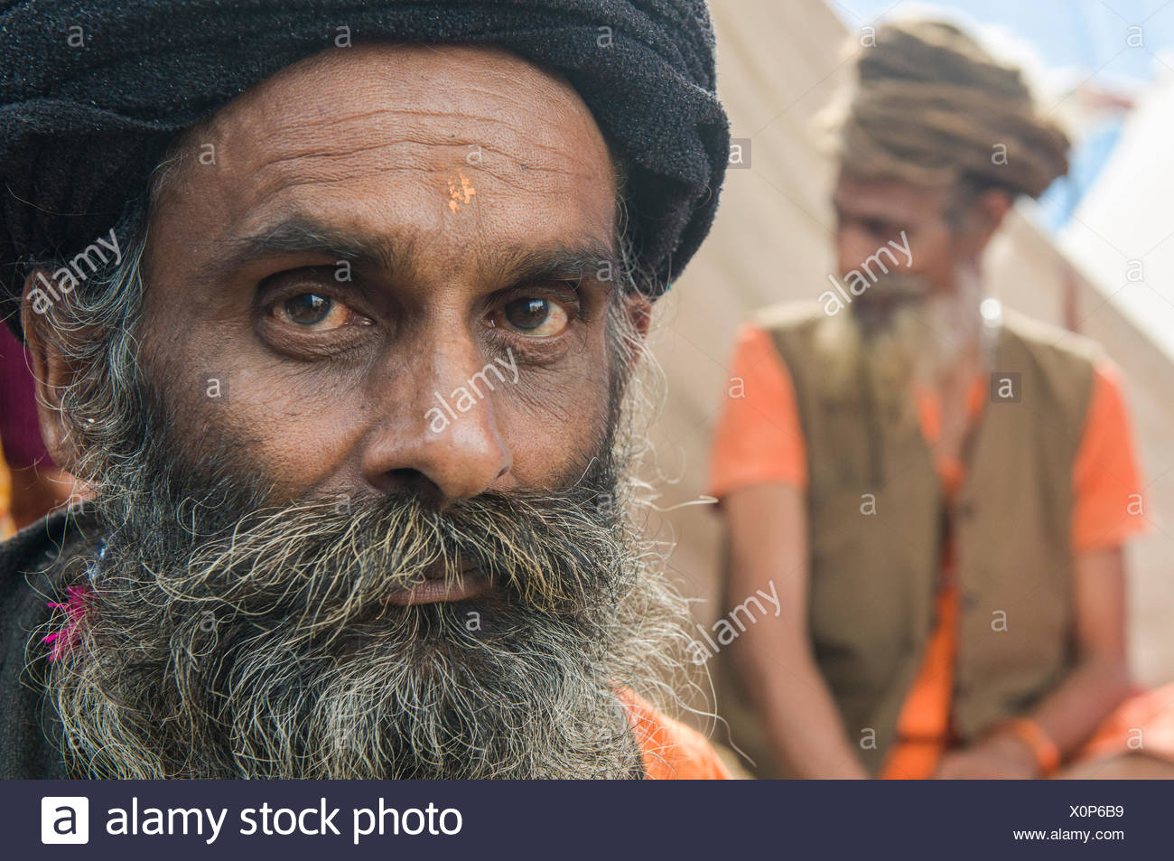 Portrait of a Udaisin Sadhu, holy man, at the Sangam, the confluence of the rivers Ganges, Yamuna and Saraswati - Stock Image