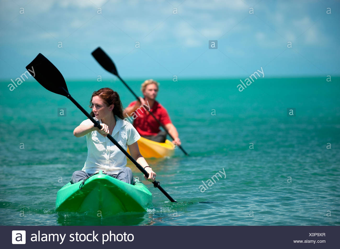 A man and woman kayak in Florida. - Stock Image