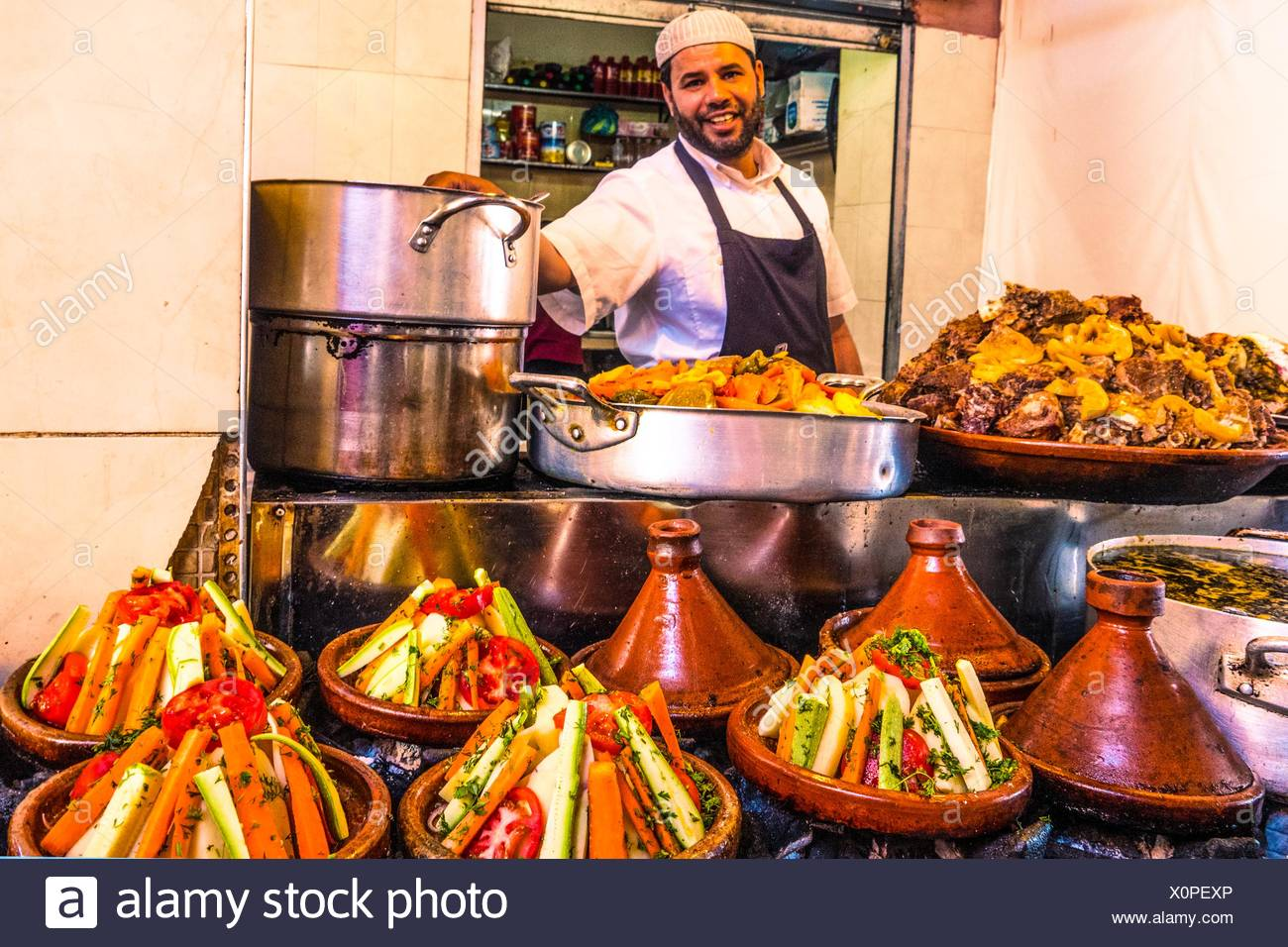 Food stand with many ´tajines´ on Place Djema El Fna, Marrakesh, Morocco - Stock Image