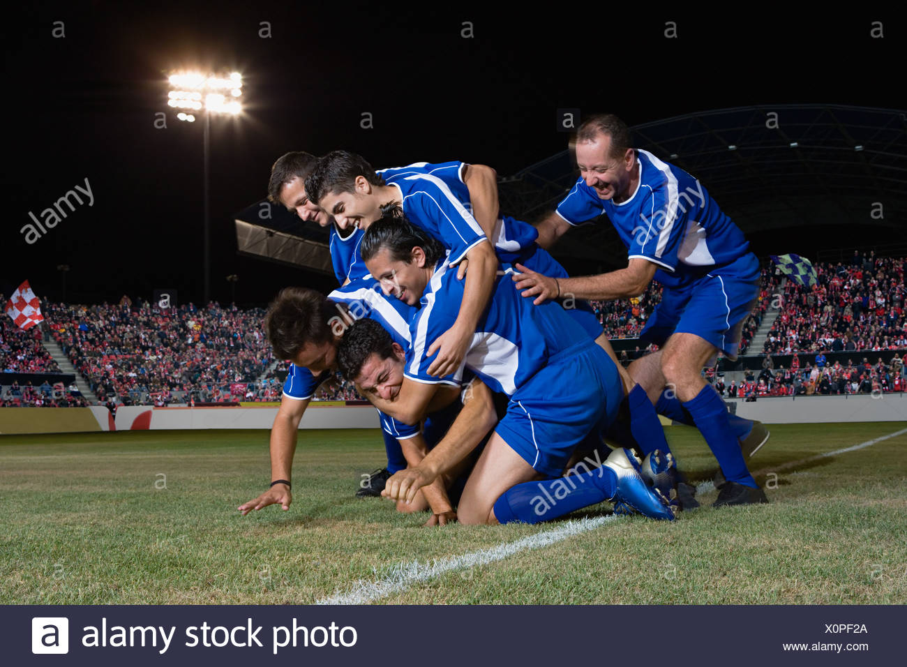 Football team celebrating - Stock Image