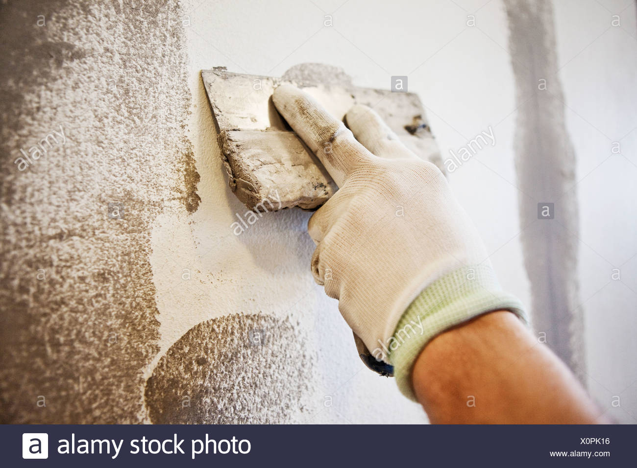 Caulking blade being used to spread filler - Stock Image