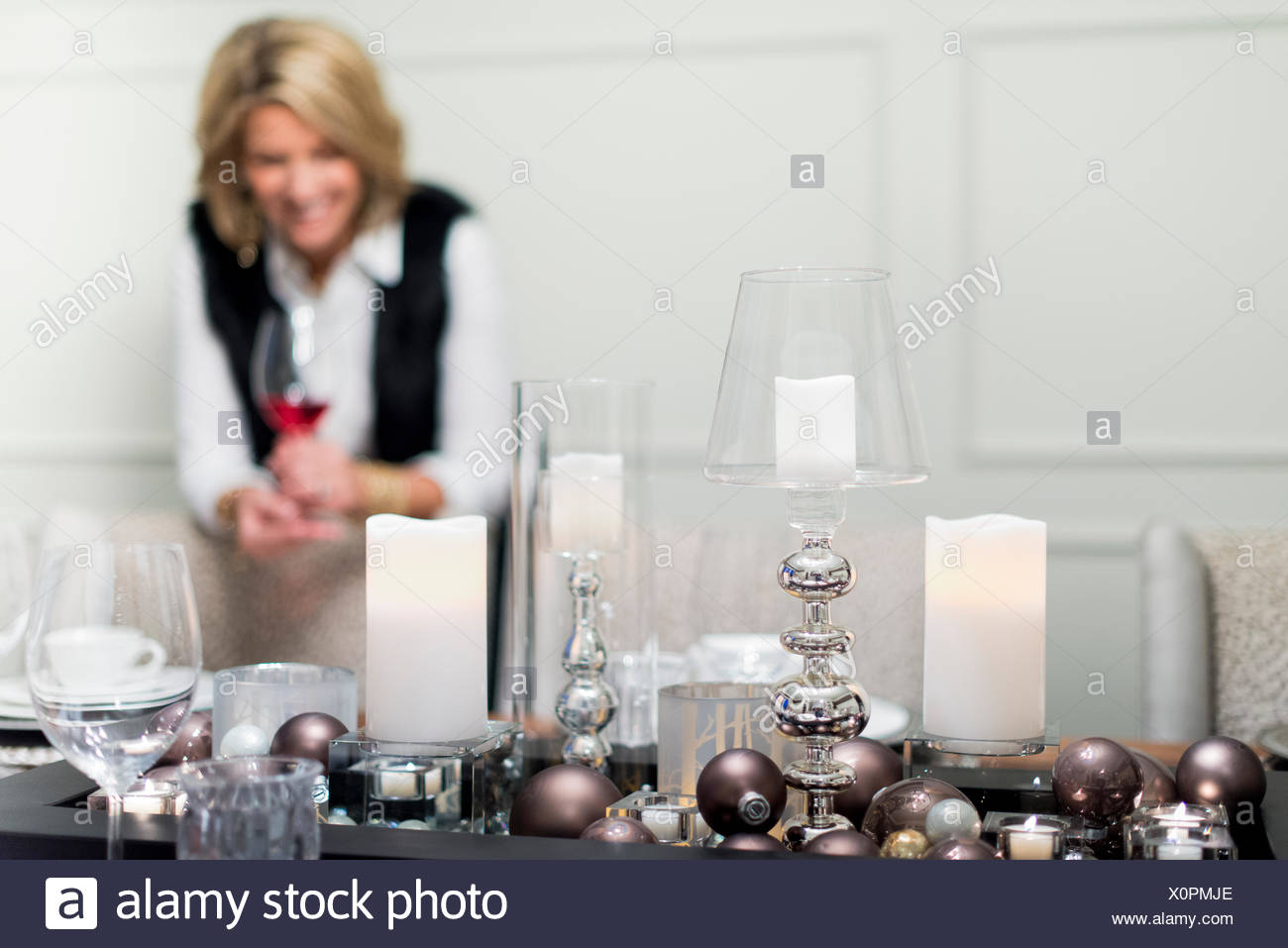 Family together for Christmas in large house with beautiful decorations. Stock Photo